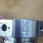 Engraved number of steel part