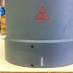 engraved Heat symbol on composite part